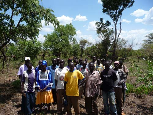 Farmers group at one of the apiary at Paicho district.