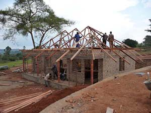 Getting the roof up for the guest house.