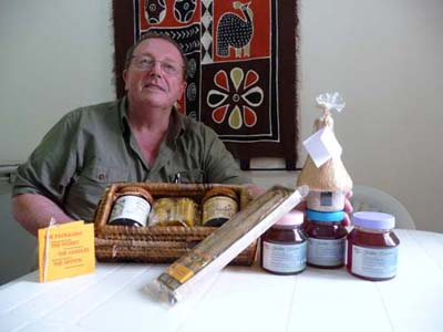 Ray and a display of honey and honey products that will be produce at Timothy Centre.