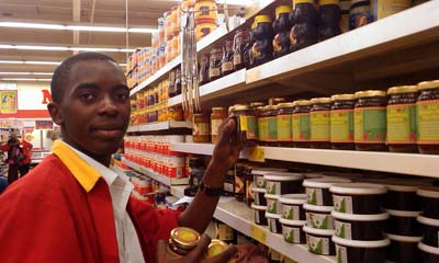 Shoprite staff arranging honey shelf.